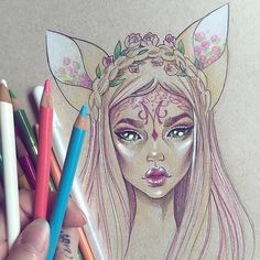 Elf girl drawing in coloured pencils