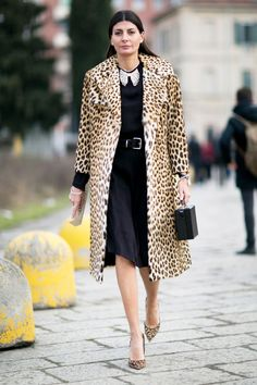 A leopard coat and matching pumps are worn with a black belted dress