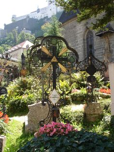 A grave with hand-wrought iron cross in the historic graveyard of St. Peter's in Salzburg, Austria (Photo: Claudia Juestel)