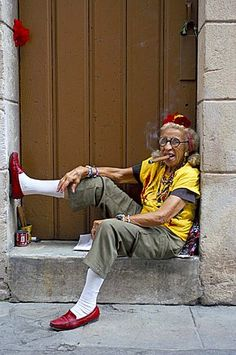 Old lady smoking cigar, Calla Empedrado, Havana, Cuba