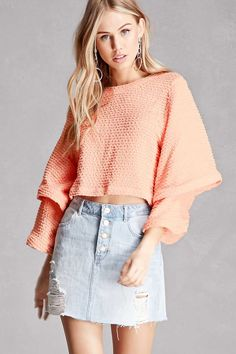 A knit top featuring oversized tiered sleeves, an allover textured chevron pattern, a round neckline, and a boxy silhouette. This is an independent brand and not a Forever 21 branded item.