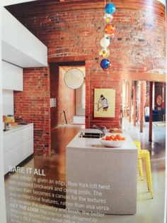 utilitarian? exposed brick and handleless cupboards. Floor to ceiling though