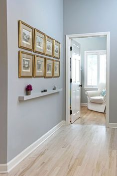 pictures with shelf underneath - helps break up the wall - could do a couple shelves - 2 sets of pics + shelf? Hallway Walls, Hallway Ideas, Entry Hallway, Wall Ideas, Modern Radiator Cover, Narrow Shelves, Hallway Decorating, Custom Furniture, White Walls
