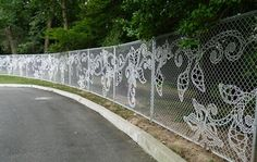 This is done with woven wire, but I wonder if something similar could be done without having to reweave the fence.