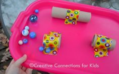 Tape toilet paper rolls to a tray, add marbles and try to get them to roll through.