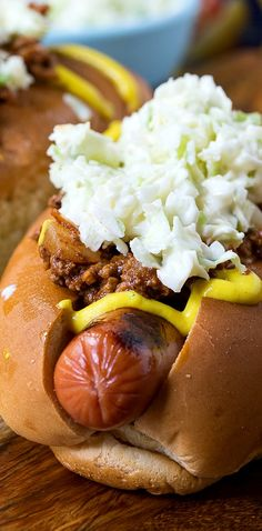 Carolina-Style Slaw Dogs with mustard, homemade chili, and creamy coleslaw.
