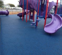 Blue seems to be a very popular color these days for playground surfacing! No Fault installed over 2,400 square feet of No Fault Safety Surface for the play area at Royal Castle Child Development Center in New Orleans, LA. Who knew that royal blue rubber surface could look so good with purple playground equipment! The red posts add to the great color combination!