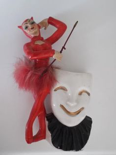 DEVIL GIRL FIGURINE 1950's (please follow minkshmink on pinterest)