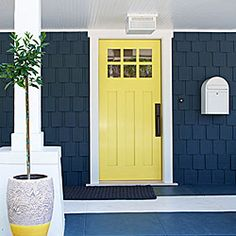 Hmmm, I really like this color combo - when I repaint the house, maybe do the lower half in dark blue with the upper yellow as well as the front door.