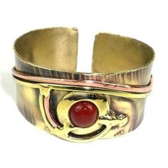 Carnelian Eye Cuff Handmade and Fair Trade. Handcrafted by South African artisans, this elegant wide brass cuff is adorned with scrolls of polished copper and brass and finished with a carnelian stone. Kids Bracelets, Jewelry Bracelets, Bracelet Display, Brass Cuff, Layout, Healing Bracelets, Carnelian, Crystal Necklace, The Ordinary