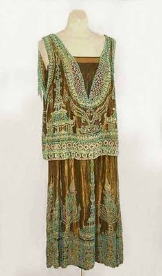 Worth gold lamé evening dress with turquoise Orientalist beading, circa 1923, via the Vintage Textile archives. by lupe
