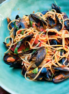 Spaghetti with mussels and tomato sauce is a classic summer dish and something you see in every restaurant on Italy's Amalfi coast. Angela Hartnett's recipe from A Taste of Home is quick and easy – and one delicious mouthful will immediately transport you to the finest Italian restaurant. Buon appetito!