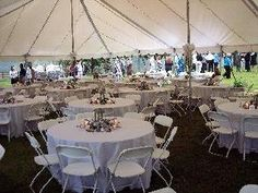 Wedding Tent With White Tablecloths And Folding Chairs Open Sides