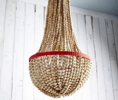 Wonder if C could make this for her room in sea glass beads? DIY Beaded Chandelier | House & Home | Photo by Angus Fergusson