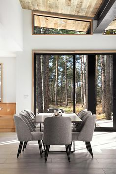 This dining room from a home in Lake Tahoe, California, has views to the outside through large windows.