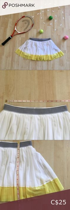 """Tennis golf skirt skort shorts mesh athletic wear Mesh athletic wear golf skirt skort shorts combo. Pleated white & yellow mesh top layer, stretchy opaque white skirt middle layer with opaque white shorts underneath. Black & white striped elastic waistband. I can't find a brand or tags - it has a """"0683"""" arrow logo on the shorts, which I can't find a match for online. The more I look at it, I think it may be handmade. One very small mark on back left short leg but not at all noticeable… Golf Skirts, Cute Skirts, Arrow Logo, Types Of Skirts, Tennis Clothes, Short Legs, Black White Stripes, Fashion Lookbook, Athletic Wear"""