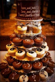 I love the cupcake tier idea. It would be fun to have geeky symbols on the cupcakes. :)