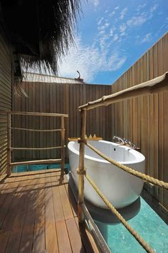 Outdoor bath - Constance hotel wood deck, tub on pool