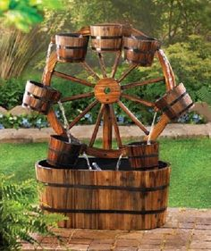 An old-fashioned western wagon wheel becomes a quaint backdrop for a dazzling display as water dances from bucket to bucket in to the barrel at the bottom.  U/L recognized 120V plug-in-the-wall submersible pump included.  28 in x 13 in x 33 in ...