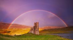 Ardvreck Gold - Ardvreck Castle Loch Assynt Scotland  On a rainy dreary afternoon when Marianne and I fell asleep in the car while waiting for a sunset shoot at this location, the sun suddenly beamed through a gap in the clouds leading to this incredible rainbow. Of all the rainbows I have seen, this one is definitely the most vivid and fortunately we were in a wonderful position to photograph it (though it meant sprinting across the headland to get to the preferred vantage point!) I pre...