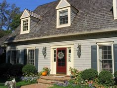 Tan House With Black Shutters Brown Call It Taupe