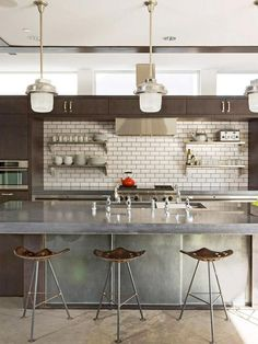 Industrial Modern Kitchen. My kitchen looks so much like this! My ceilings aren't as high but I do love my stainless open shelves.