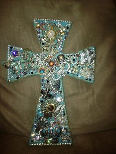 Wooden cross decorated with old fashion jewelry posted by a friend of mine.