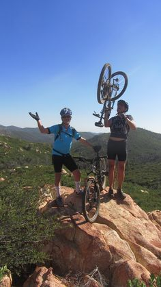 Two mountain bikers on a boulder, San Diego - Photo by Patty Mooney of Crystal Pyramid Productions - http://sandiegovideoproduction.com/video-producers/patty-mooney/