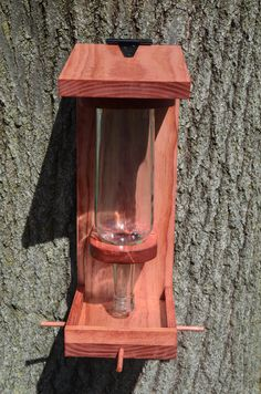 Hey, I found this really awesome Etsy listing at https://www.etsy.com/listing/228529684/wine-bottle-bird-feeder