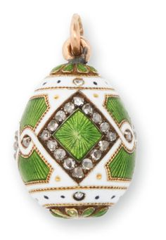 A Fabergé jeweled gold and guilloché enamel Easter egg pendant, workmaster Michael Perchin, St. Petersburg, 1898-1903, enameled in translucent green over an engine-turned ground within diamond-set borders and an opaque white ground.
