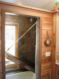 Space saving shower/bath combo. Tub is sunk into floor, teak grid on top. Shower water runs through grid out through tub drain, raise shower floor for bath.