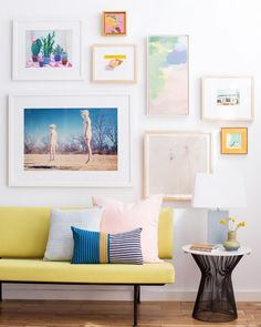 Living room with a bright pastel colored gallery wall and a chartreuse sofa