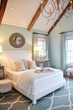 Neutral bedroom. Love the wall color & the high ceilings with beams!