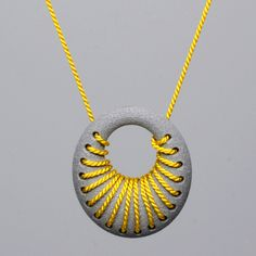 Featured at SXSW 2013: 3D Printed aluminum loop pendant with silk cord woven into the design! Buy yours today at seedling-design.com