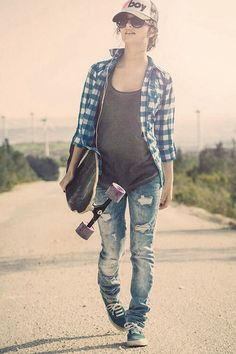 tattered and torn skinny jeans, converse tennies, loose gray racerback tank, unbuttoned plaid or checkered collared shirt, big shades, and a cap.