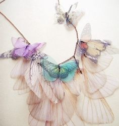 """$125 by JewelEra on etsy: """"Another gorgeous and unique neck piece for my butterfly collection I originally created for one of my clients who loved the original Fluttery Breath of Life Necklace though wanted something more simplified.    """"I made it by transferring real butterflies and moth wings images onto organza fabric. After cutting each of them, I cluster the pieces into a necklace that is so whimsical, unique and nothing like you'd see somewhere else!"""""""