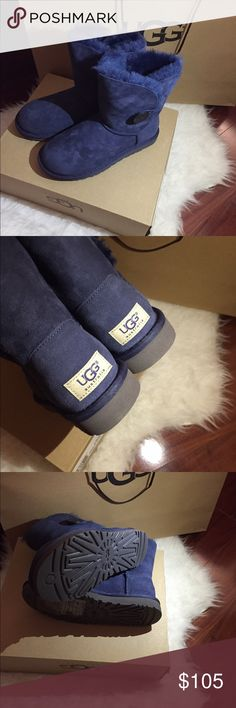 UGG NEW  BAILEY BUTTON MINI WOMEN🐨🐨🐨🐨💙💙 New with tag and shopping bag ,no box .They can be worn cuff down .Gorgeous dark Navy blue color,with a Navy blue matching button!💙 this beauty is 100% authentic with QR reader scannable don't miss out on this special price week end special UGG Shoes Ankle Boots & Booties
