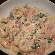 An Old Boyfriend's Mother Used To Cook This For Me Whenever I Ate Over. Cheese Tortellini Are Served In A Creamy Tomato And Spinach Sauce. I Love It!