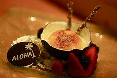 """My favorite dessert from the Hyatt Regency Maui where we go for our """"stay-cations"""".  Coconut Creme Brulee (coconut shell is white & dark chocolate) on a bed of brown sugar, with blackberries, raspberries and strawberries."""