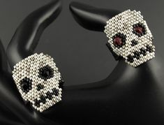 Halloween Skull Rings...Peyote Seed Bead.Five Galvanized Metal Delica Beads Placed Randomly with Black Accents & Swarovski Bicone Eyes by CabinFeverBracelets on Etsy https://www.etsy.com/listing/471530949/halloween-skull-ringspeyote-seed