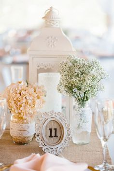 rustic, romantic reception decor for a barn wedding / http://www.deerpearlflowers.com/lantern-wedding-centerpiece-ideas/2/