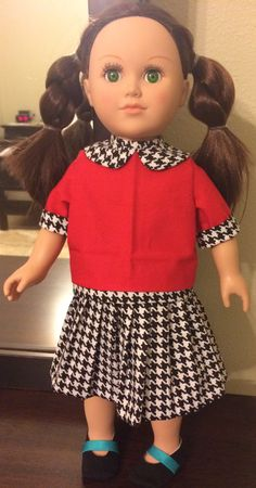 American Girl doll dress. Red shirt with black and white hounds tooth detail on collar and sleeves. Black and white hounds tooth, long skater skirt.