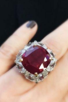 Beautifully set cushion-cut Burma ruby ring of 13 carats by Bulgari.