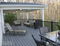 This modern oasis showcases Trex Island Mist decking with an aluminum railing system. The main feature of the project is the covered section finished with a white vinyl ceiling.