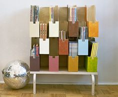 Build a multitiered magazine rack. This is such a fantastic idea. Mine are taking up room as a huge stack! Might as well be pretty.