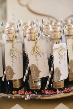 Mini wine bottle favors with custom labels designed by @Minted ...