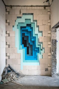 Since 2009, German street artist 1010 has been creating these mysterious, portal-like street art illusions on walls around the world. While at first glance it looks like he's layering colored paper, upon closer inspection you realize that you're actually looking at paint on a wall. It's a different type of street art than we're used to. Recently, for the urban and contemporary art festival in Hamburg called Knotempunkt, 1010 created a huge mural that was layered in colors; blue, purple, red…
