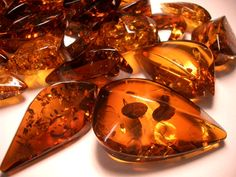 Dark cognac amber pendants appreciated for its colour and natural beauty since Neolithic times.