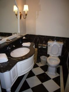 Black and white bathroom with large tiles