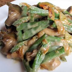 Green Bean casserole with mushrooms bacon cheddar and no soup… and so delicious.